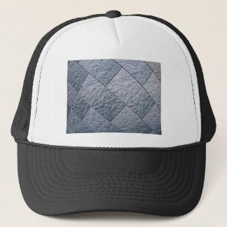 Fragment of gray decorative wall trucker hat