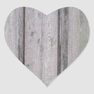 Fragment of old wooden fence heart sticker