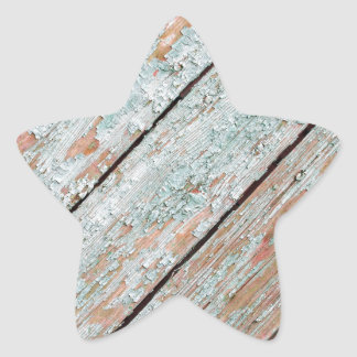 Fragment of the surface of the old wooden planks star sticker