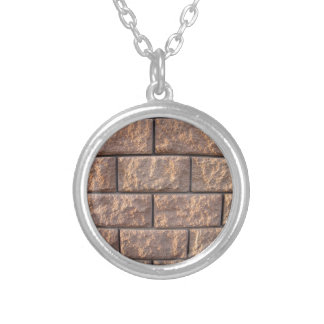 Fragment of the wall of the large concrete blocks round pendant necklace