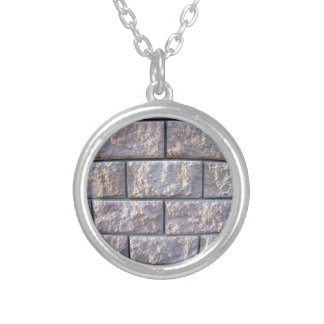 Fragment of the wall of the large gray concrete bl round pendant necklace