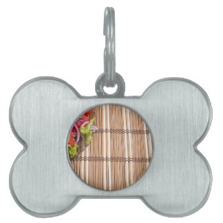 Fragment of transparent plate of fresh vegetarian pet ID tag