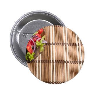 Fragment of transparent plate of fresh vegetarian pinback button
