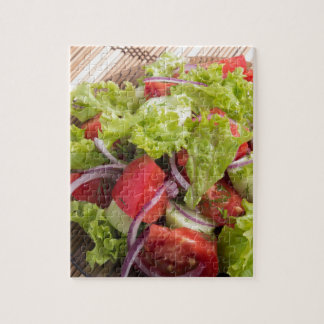 Fragment of vegetarian salad from fresh vegetables jigsaw puzzle