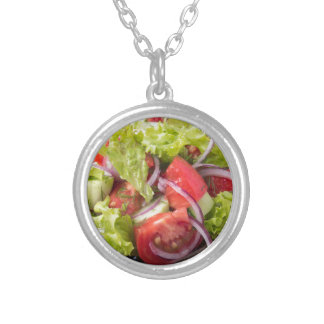Fragment of vegetarian salad from fresh vegetables silver plated necklace