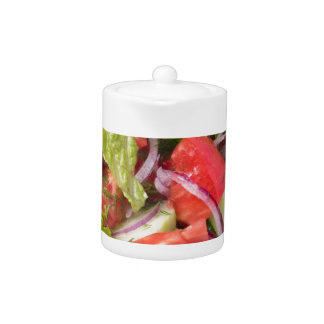 Fragment of vegetarian salad from fresh vegetables teapot