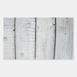 Fragmento de la cerca de madera vieja pintada gris pegatina rectangular