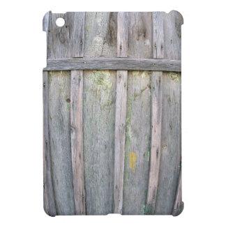 Fragmento de una cerca de madera vieja de tableros