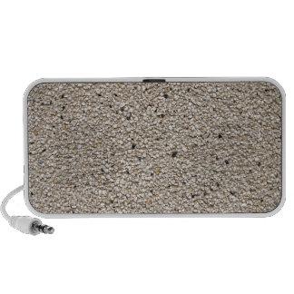 Fragmento de una pared hecha de pequeñas piedras iPod altavoz