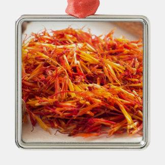 Fragrant saffron close-up metal ornament