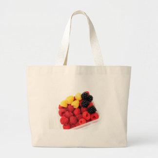 Frambuesas rojas y de oro bolsa lienzo