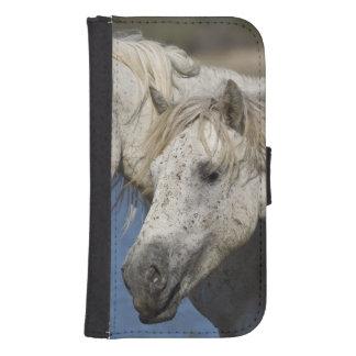 France, Camargue. Horses run through the Phone Wallets