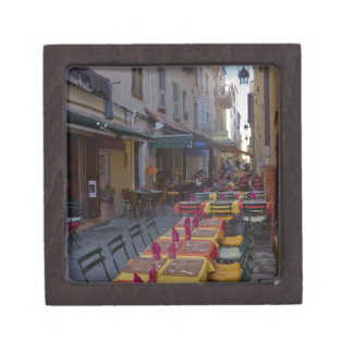 France, Corsica. Tables of cafe set up in narrow Jewelry Box
