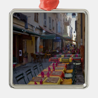 France, Corsica. Tables of cafe set up in narrow Metal Ornament