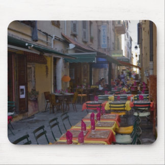 France, Corsica. Tables of cafe set up in narrow Mouse Pad