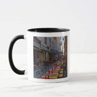 France, Corsica. Tables of cafe set up in narrow Mug