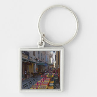 France, Corsica. Tables of cafe set up in narrow Silver-Colored Square Keychain