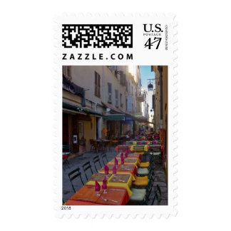 France, Corsica. Tables of cafe set up in narrow Stamp