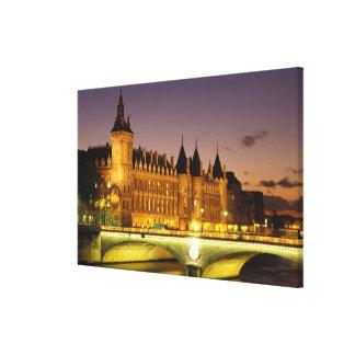 France, Paris, Conciergerie and river Seine at Canvas Print