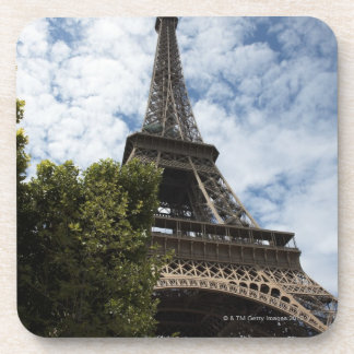 France, Paris, Eiffel Tower and tree, low angle Coaster