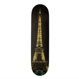 France, Paris. Eiffel Tower at night with Skateboard