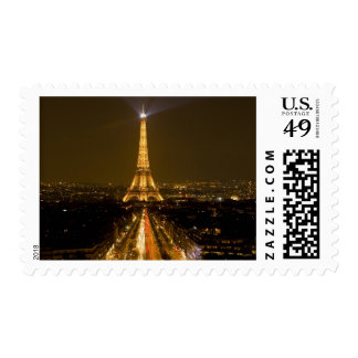 France, Paris. Nighttime view of Eiffel Tower Postage