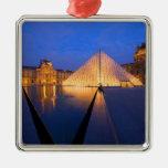 France, Paris. The Louvre museum at twilight. Ornaments