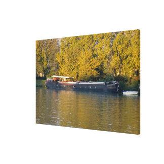 France, Rhone River, near Avignon, barge along Canvas Print