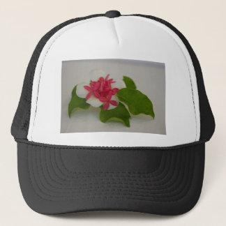 Frangipani flower arrangement trucker hat