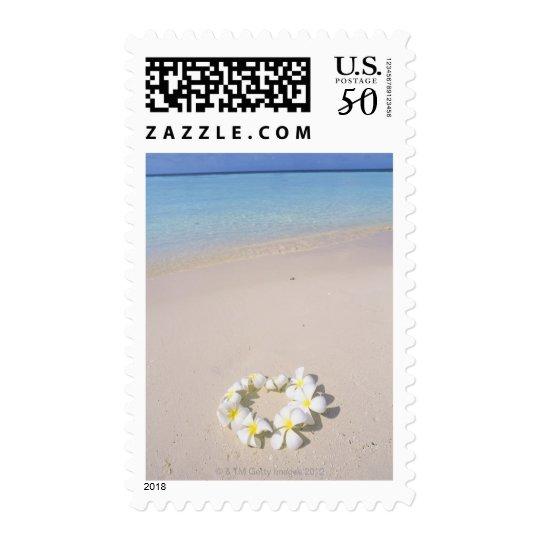 Frangipani on the beach postage