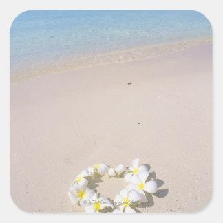 Frangipani on the beach square sticker
