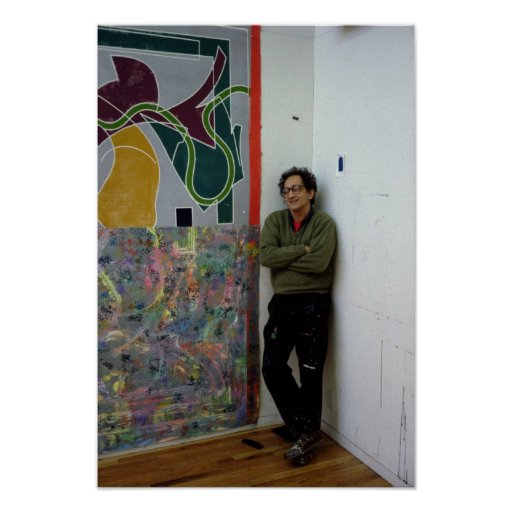 Frank Stella  beside one of his works Print