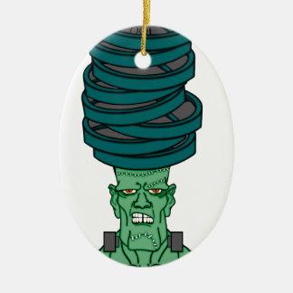 Frankenstein bajo pesos adorno navideño ovalado de cerámica