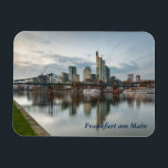 """Frankfurt am Main Magnet<br><div class=""""desc"""">An evening photo of the River Main with skyline in Frankfurt am Main, Hessen, Germany is featured on this souvenir magnet. The text is customisable or removable. The magnets make an ideal gift, or a personal present to stick on your fridge or filing cabinet. This magnet measures 7.6 cm x...</div>"""