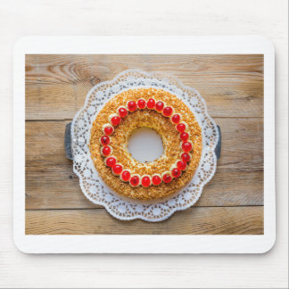 Frankfurt crown cake with cherries on rustic wood mouse pad