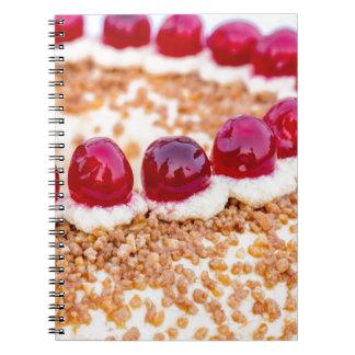 Frankfurt crown cake with cherries on rustic wood notebook