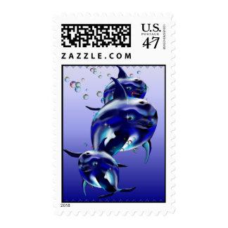 Franqueo azul de tres delfínes sellos