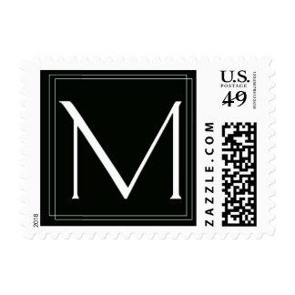 Franqueo blanco y negro elegante del monograma M