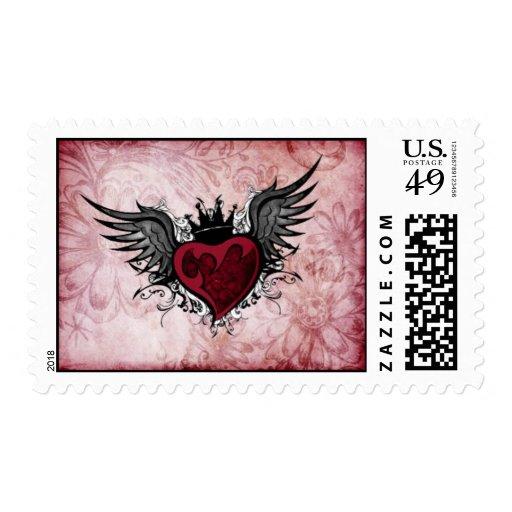 Franqueo con alas tatuaje del corazón del vintage