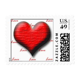 Franqueo de los corazones de la tarjeta del día de