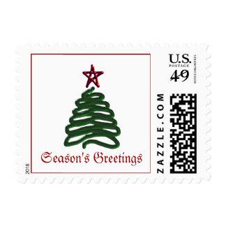 Franqueo del árbol de navidad de los saludos de la estampilla