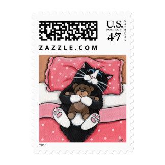 Franqueo del gato negro y del oso de peluche sello postal