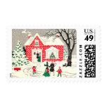 Franqueo del medio de los saludos del navidad del sello postal