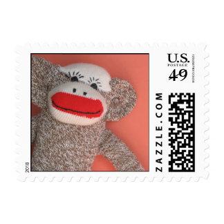 Franqueo del mono del calcetín sellos