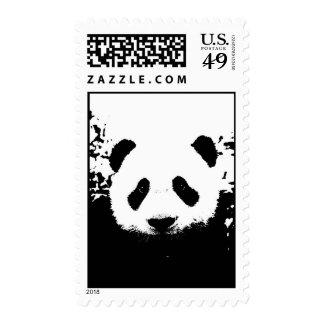 Franqueo negro y blanco de la cara de la panda