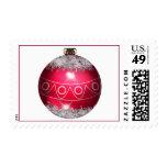Franqueo rojo de la bola del navidad