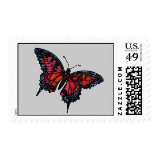 Franqueo rojo de la mariposa sellos