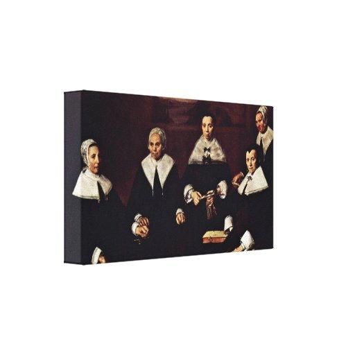 Frans Hals - Group portrait of the regents Canvas Print