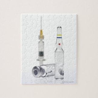 Frascos que contienen la medicina para las inyecci rompecabeza con fotos