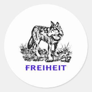 Freedom - wolf in wilderness classic round sticker